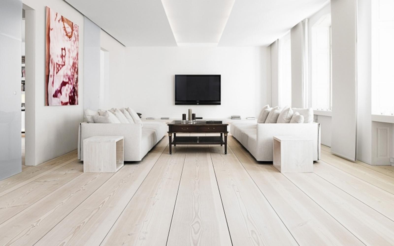 Source Deavita -parquet-bois-massif-blanchi-salon-blanc-symétrique